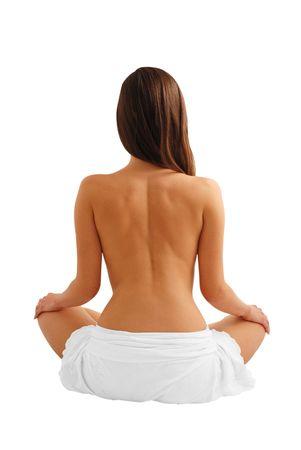 Naked back of beautiful female model sitting as lotus, palms on knees, isolated on white Stock Photo