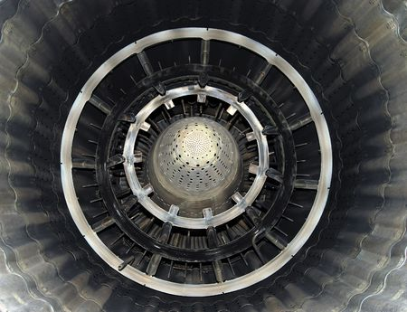 Turbine of military airplane from within, close up, metallic blades and circles, shining symmetric patterns Reklamní fotografie