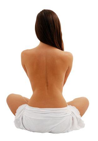 Naked back of beautiful female model sitting as lotus, long dark hair, isolated on white Stock Photo - 3811036