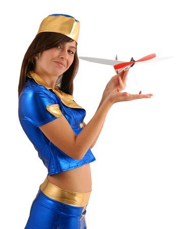 様式化された紺のスーツの女性モデルを白で隔離されるおもちゃの飛行機を示します