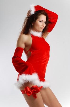 velvet dress: Fairy in short velvet dress with white down list, red bow tied on slender leg, seductive pose, side view