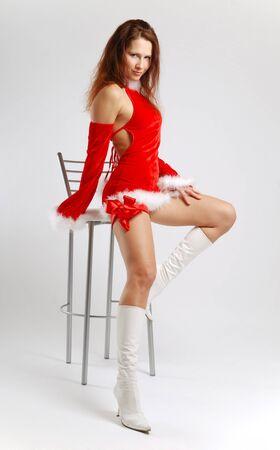 velvet dress: Fairy in short velvet dress with down list, slender legs in white boots high-heeled, seductive pose