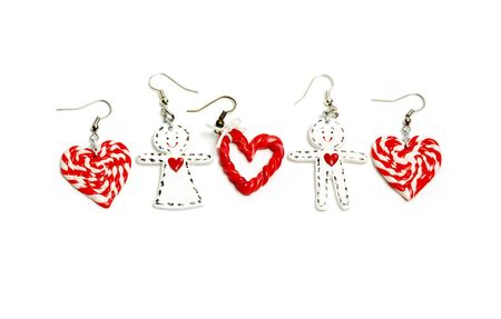 bijouterie: Ear-rings in the form of man and woman with hearts isolated on white