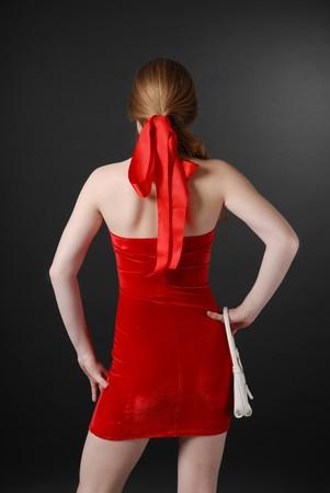 velvet dress: Short velvet dress on slender girl and red ribbon in fair hair