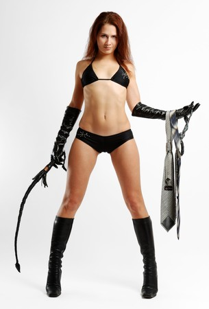 Stripped girl with male cravats and knout, in black lingerie, boots and gloves Stock Photo - 4340619