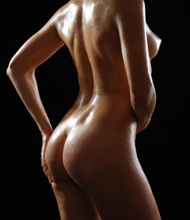 Lustrous body of young woman, side view Stock Photo