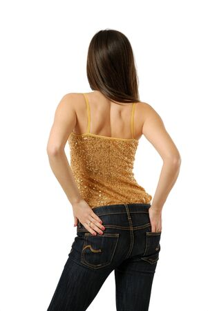 Slender body of teenage girl standing back, hands in hip-pockets photo