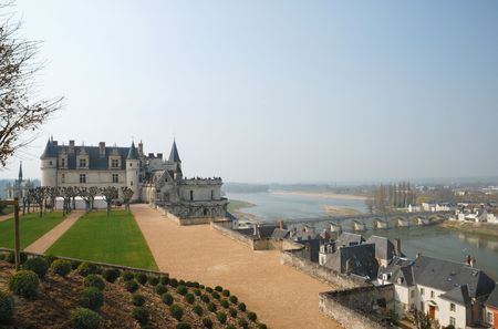 Medieval chateau above valley of Loire with bridge, river and town Amboise photo