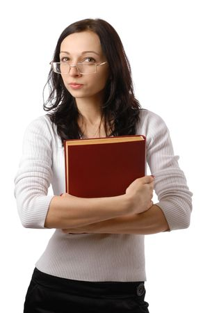 Pretty woman looking fishily through eyeglasses with big book in hand photo
