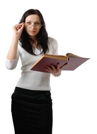 Slender girl holds open big book and looks over glass. Young brunette is wearing black skirt and white blouse. photo