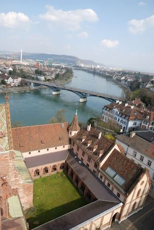 High angle view of an old world city and bridge with a river running through it. Vertical shot of Basel. Standard-Bild
