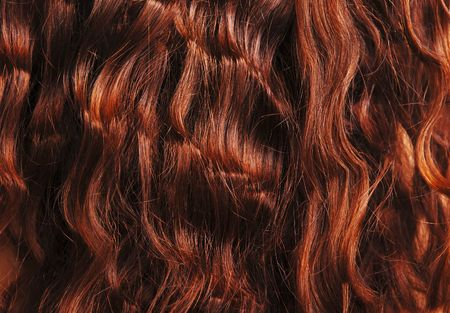 Close-up of red curly hair, hairdressing background photo