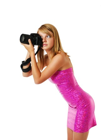 slinky: Pretty girl is photographing with a big camera. She is wearing a pink strapless dress. The blonde is photographed from one side. Her sexy body is beautifully accentuated with the slinky dress. Stock Photo