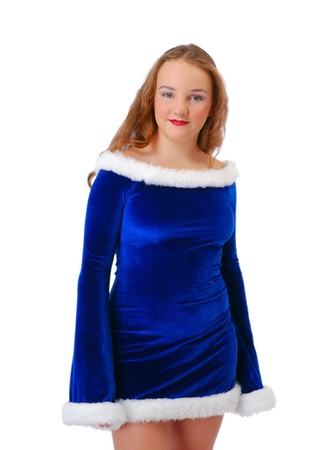 velvety: Shy teenage girl is standing and looking at the camera. She is wearing blue velvety dress decorated with white fluff.