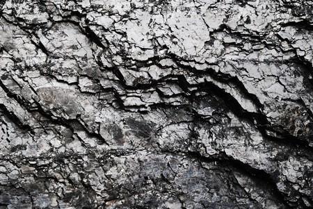 黒の光沢のある石炭表面のひび。地質鉱物燃料の背景。 写真素材