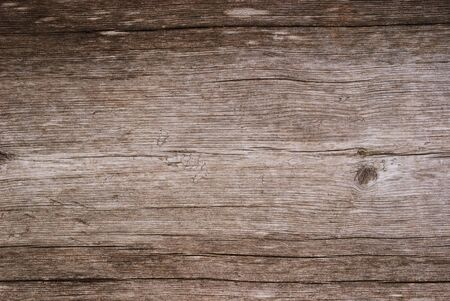 Wood wall is made of boards. This is the timber background of weathered planks. photo