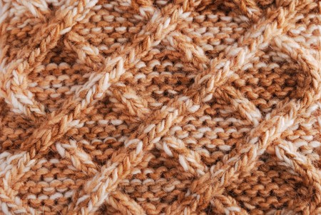 Knitted cloth is made by hand. It is decorated with rhombic bulging pattern. photo
