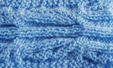bulging: Blue knitted cloth is made by hand. It is decorated with vegetable bulging pattern. Stock Photo