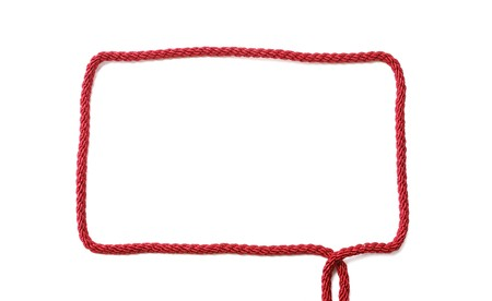 Right-angled frame is made with red cord for knitting. It is empty and isolated on white. It has two tails. There is copy space.