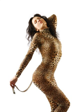 Sexy woman is bending as a cat. She is wearing leopard catsuit. Stok Fotoğraf