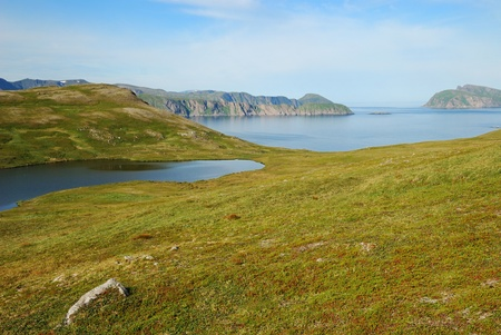 capes: Soroya is a large island in western Finnmark of Norway. There are blue lakes, moss steep hills, numerous capes and islets in the north sea.