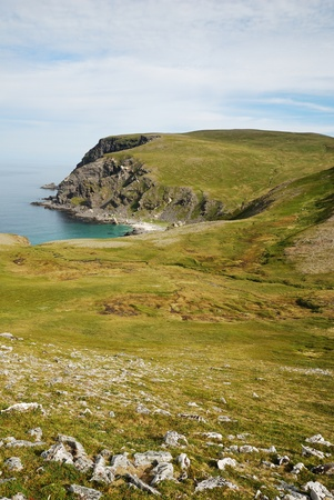 Soroya is a large island in western Finnmark of Norway. There are blue bays, moss steep hills and gently sloping headlands stretching into the north sea. photo