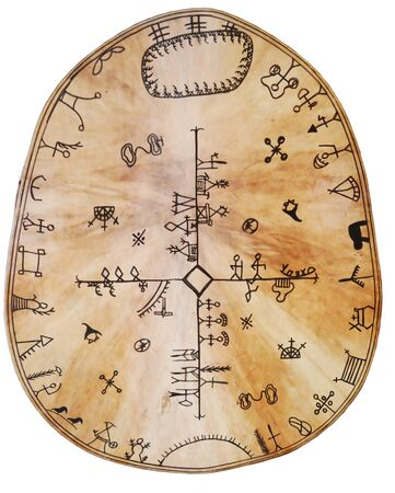 Sami tambourine is made of reindeer's leather. It is decorated with pictures. It is isolated on white. Standard-Bild