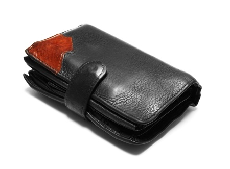 billfold: Black leather billfold is packed with money and cards. It is isolated on white. Stock Photo