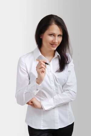 Cheerful businesswoman is standing and explaining something. The happy woman is looking at the camera and speaking. She is wearing a white blouse and black trousers. Stock Photo - 11479087