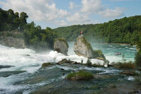 The Rhine Falls is the largest plain waterfall in Europe. It is located on the Upper Rhine near the town of Neuhausen in northern Switzerland. Stok Fotoğraf