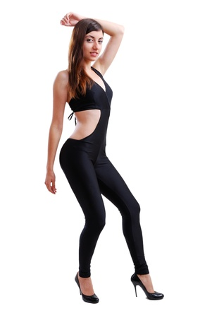 Young woman is bending her attractive body and looking at the camera. She is wearing a black catsuit. Stock Photo - 14328885