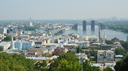 Kyiv is photographed in summer  In the right bank of the river Dnipro there is the old borough Podol with a port and bridges   Stock Photo