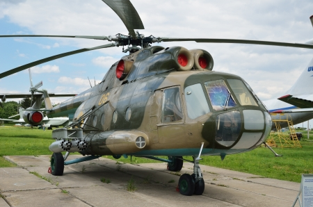 A multipurpose helicopter Mi-8MT Hip-H is on the green field against the overcast sky  Stock Photo - 14963409