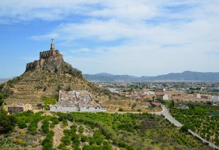 The steep hill of Monteagudo protrudes over the Segura river photo