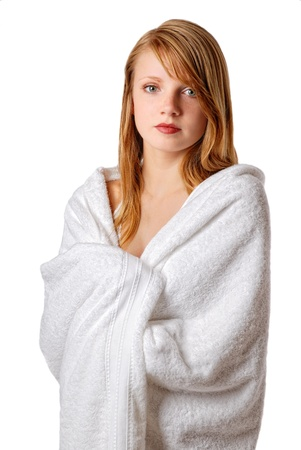 Pretty young woman wrapped herself warm in a bath terry towel. She feels comfortable. Stock Photo