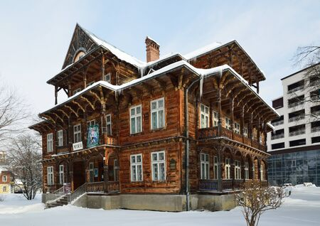gabled: An old Swiss chalet was built in the famous balneology resort Truskavets in the late 19th century. The wooden building has gabled roof, large windows and carving balconies.