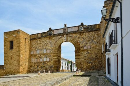 regenerated: Arco de los Gigantes was built in 1595 in honour of King Philip II of Spain. It leads to the medieval Arabian castle Alcazaba. Stock Photo
