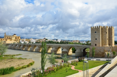 1st century: Roman bridge is over the Guadalquivir river in Cordova  It was built by the Romans in the early 1st century BC and restored several times  It has a length of about 250 meters and consists of 16 arches  Stock Photo