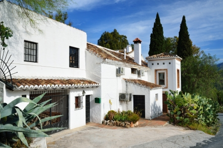 Typical Spanish house is in the middle of large agaves and cactuses Stok Fotoğraf