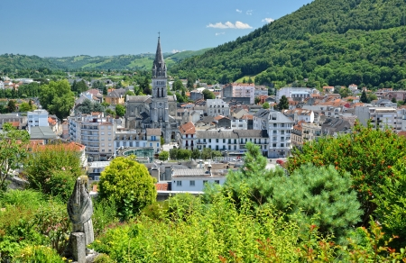 Lourdes is a major place of Roman Catholic pilgrimage  It is a small market town lying in the foothills of the Pyrenees  Stock Photo - 16745770