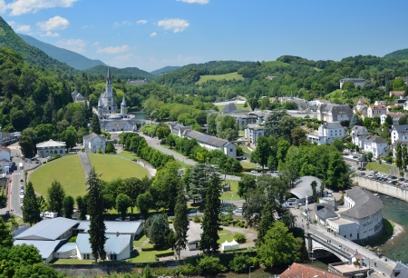 Lourdes is a major place of Roman Catholic pilgrimage and of miraculous healings  It is a small market town lying in the foothills of the Pyrenees Stok Fotoğraf - 16762094