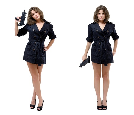 Serious young woman is standing in two different poses and holding a submachine gun photo