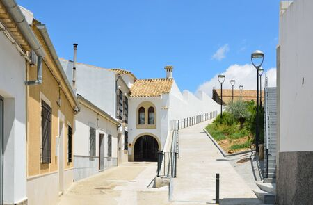 backstreet: The side street is sunlit under the spring sky in the Spanish white town Montilla