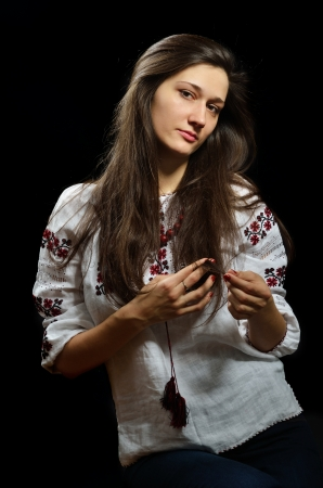ukrainian ethnicity: Beautiful young woman is wearing a shirt embroidered  This is an authentic clothing of Ukrainian ethnicity
