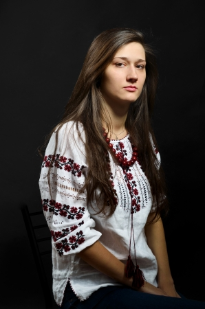 ukrainian ethnicity: Beautiful young woman is wearing a shirt embroidered. This is an authentic clothing of Ukrainian ethnicity. Stock Photo