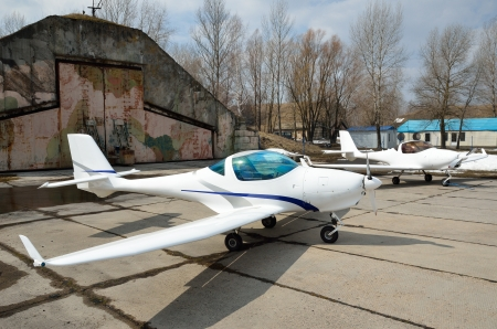 Modern lightweight planes are on the aerodrome  photo
