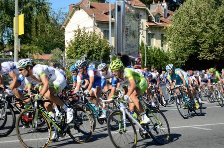 Peloton of the cycle race is racing in the street of the French town Pau