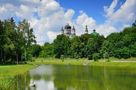 Feofaniya is the youngest garden in Kiev  This is a beautiful sample of the landscape architecture  Panteleymonovsky cathedral towers under it  photo