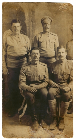 twentieth: Four military men are photographed on the old-fashioned image of the beginning of the twentieth century  Editorial