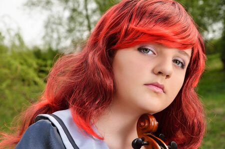 animation teenagers: A pensive cosplayer is photographed close-up outdoors